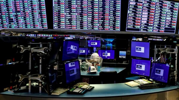Dividers are seen inside a trading post on the trading floor as preparations are made for the return to trading at the New York Stock Exchange (NYSE) in New York, U.S., May 22, 2020. - Sputnik International
