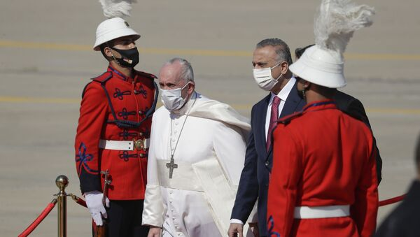 Pope Francis is greeted by Iraqi Prime Minister Mustafa al-Kadhimi upon his arrival at Baghdad's international airport, Iraq, Friday, March 5, 2021. Pope Francis heads to Iraq on Friday to urge the country's dwindling number of Christians to stay put and help rebuild the country after years of war and persecution, brushing aside the coronavirus pandemic and security concerns. - Sputnik International