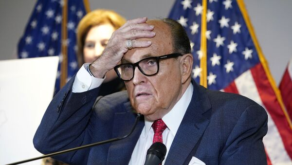 In this Nov. 19, 2020, file photo, former New York Mayor Rudy Giuliani, who was a lawyer for President Donald Trump, speaks during a news conference at the Republican National Committee headquarters in Washington - Sputnik International