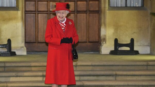 Britain's Queen Elizabeth II, along with other members of the royal family, stands in the quadrangle at Windsor Castle, Windsor, England, Tuesday Dec. 8, 2020, to meet and thank members of the Salvation Army and local volunteers and key workers from organisations and charities in Berkshire. - Sputnik International