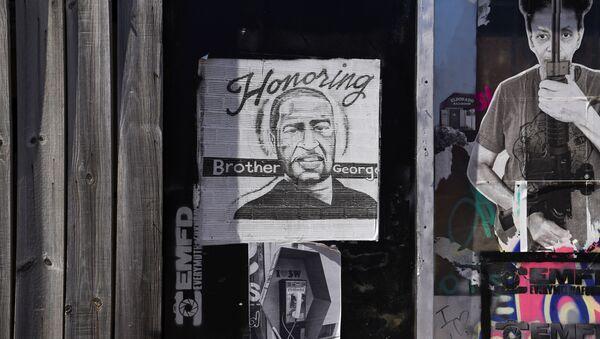 A mural honoring George Floyd is seen in the Third Ward ahead of the trial of the former Minneapolis cop Derek Chauvin in Houston, Texas, U.S., March 3, 2021. - Sputnik International