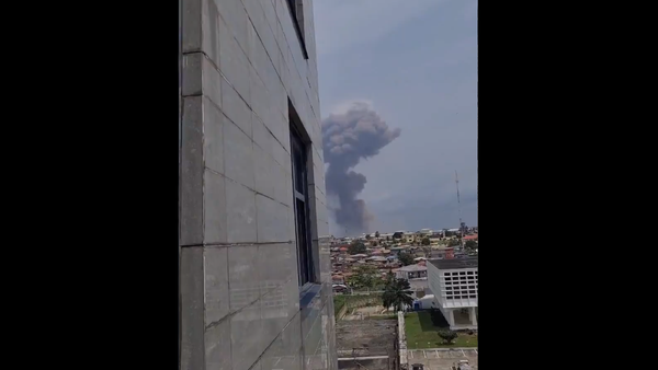 A screenshot from the video allegedly showing the smoke coming from the site of the explosion in Ecuatorial Guinea's city of Bata, posted on Twitter on March 7, 2021 - Sputnik International