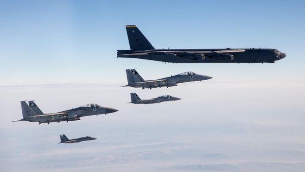 Israeli Air Force F-15 fighter Escort two American B-52 bombers through Israeli airspace on March 7, 2021 - Sputnik International