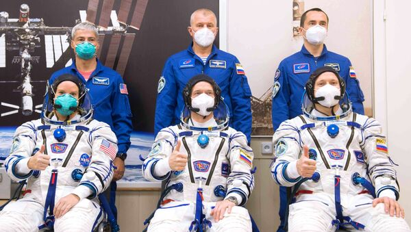 Members of the 64th expedition prime crew to the International Space Station (ISS), NASA astronaut Kathleen Rubins and Roscosmos cosmonauts Sergei Ryzhikov, Sergei Kud-Sverchkov (from left to right) in the front row and members of the 64th expedition backup crew, NASA astronaut Mark Wande Hai and cosmonauts Roscosmos Oleg Novitsky, Pyotr Dubrov (left to right in the second row) before the launch of the Soyuz-2.1a carrier rocket with the Soyuz MS-17 manned transport vehicle from the launch pad # 31 of the Baikonur cosmodrome. Image is a handout provided by a third party. - Sputnik International