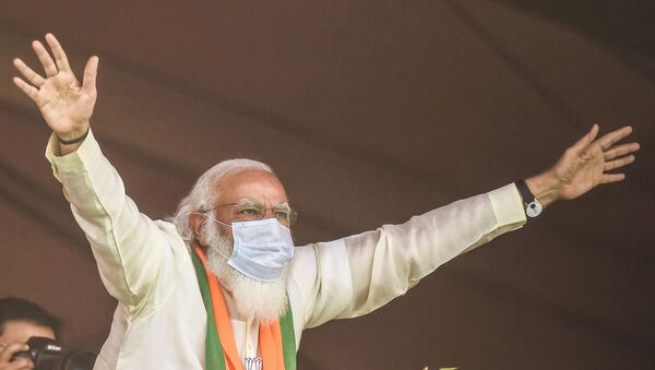 India's Prime Minster Narendra Modi addresses supporters of the Bharatiya Janata Party (BJP) during a mass rally ahead of the state legislative assembly elections at the Brigade Parade ground in Kolkata on March 7, 2021. - Sputnik International