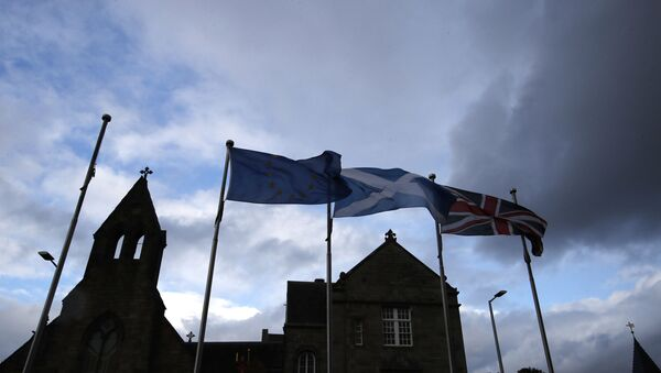 European, Scottish and Great Britain flags float in front of the Scottish Parliament in Edinburgh, Scotland, Wednesday, 4 September 2019.  - Sputnik International