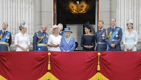 (L-R) Britain's Prince Edward, Earl of Wessex, Britain's Sophie, Countess of Wessex, Britain's Prince Charles, Prince of Wales, Britain's Camilla, Duchess of Cornwall, Britain's Queen Elizabeth II, Britain's Meghan, Duchess of Sussex, Britain's Prince Harry, Duke of Sussex, Britain's Prince William, Duke of Cambridge and Britain's Catherine, Duchess of Cambridge stand on the balcony of Buckingham Palace on July 10, 2018 to watch a military fly-past to mark the centenary of the Royal Air Force (RAF). - Sputnik International