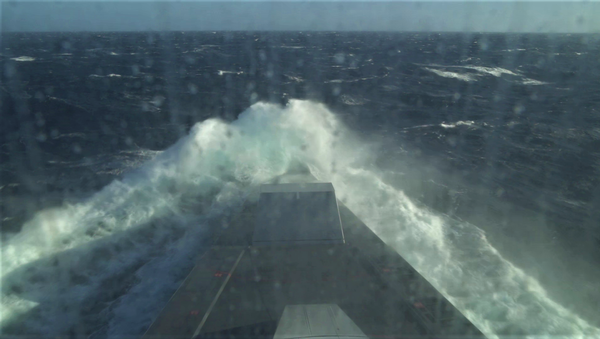 A view of the bow on USS Zumwalt (DDG 1000) during testing in Sea State 6 conditions on Oct. 25, 2020. A cloud of spray engulfed the bow as a result of pitch motion and high winds - Sputnik International