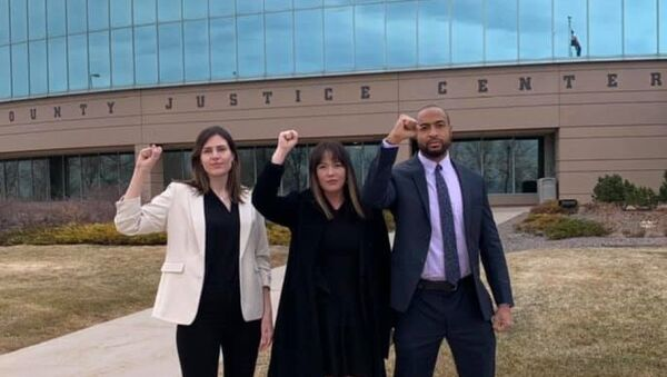 Activists Lillian House, Joel Northam and Eliza Lucero head to a pretrial hearing in Aurora, Colorado, for charges stemming from a July 2020 Black Lives Matter protest - Sputnik International