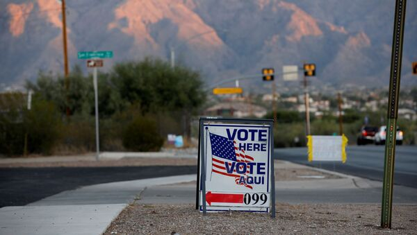 Sign directs voters to a polling station on Election Day in Tucson, Arizona, U.S. November 3, 2020. - Sputnik International