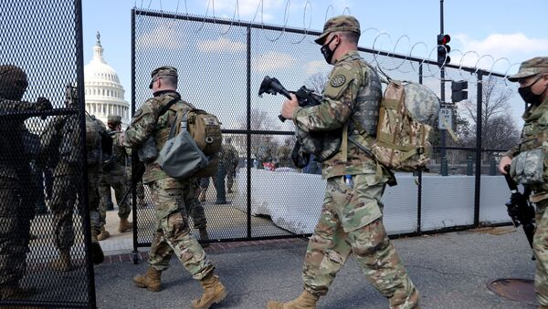 FILE PHOTO: National Guard soldiers patrol the grounds of the US Capitol after police warned that a militia group might try to attack the Capitol complex in Washington, DC, 4 March 2021. - Sputnik International