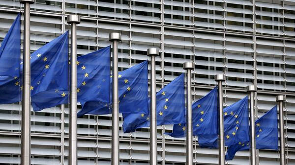 FILE PHOTO: Picture shows European Union flags fluttering outside the EU Commission headquarters in Brussels - Sputnik International