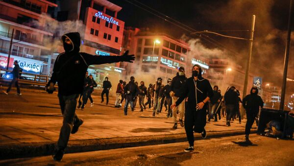 Protesters run during a demonstration against a police crackdown on gatherings, in Athens, Greece, March 9, 2021 - Sputnik International