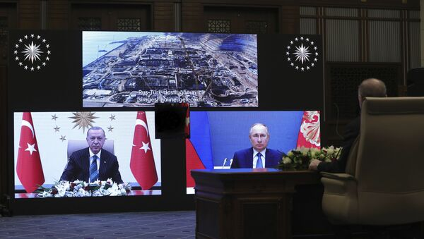 Turkey's Recep Tayyip Erdogan sitting extreme right, and on screen bottom left, with Russia's President Vladimir Putin, bottom right, speak during a ceremony as they have remotely inaugurated the construction of a third nuclear reactor of Akkuyu power plant in Mersin province on the Mediterranean coast, in Ankara, Turkey, Wednesday, March 10, 2021. Erdogan called the plant a symbol of Turkish-Russian cooperation. - Sputnik International