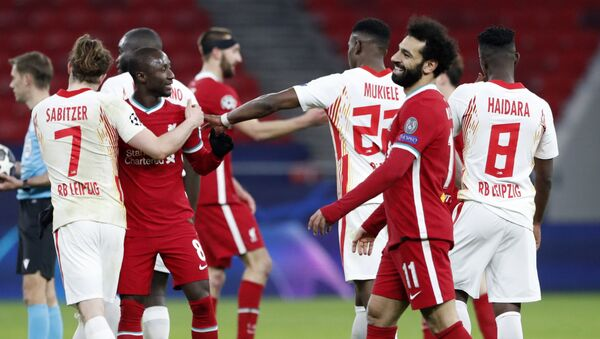Soccer Football - Champions League - Round of 16 Second Leg - Liverpool v RB Leipzig - Puskas Arena, Budapest, Hungary - March 10, 2021 Liverpool's Mohamed Salah celebrates with teammates after the match - Sputnik International