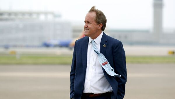 In this June 28, 2020 file photo, Texas' Attorney General Ken Paxton waits on the flight line for the arrival of Vice President Mike Pence at Love Field in Dallas. The mass exodus of Paxton's top staff over accusations of bribery against their former boss has left the Republicans seeking $43 million in public funds to replace some of them with outside lawyers to lead a high-profile antitrust lawsuit against Google. - Sputnik International