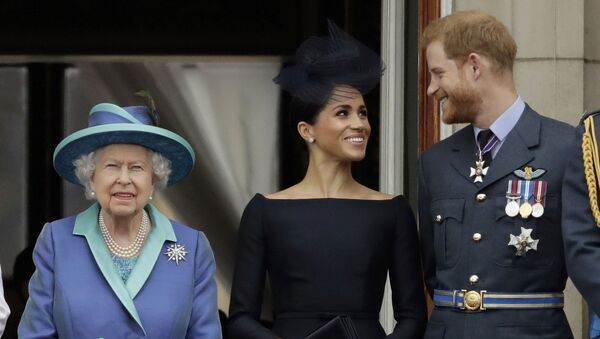 In this Tuesday, July 10, 2018 file photo Britain's Queen Elizabeth II, and Meghan the Duchess of Sussex and Prince Harry watch a flypast of Royal Air Force aircraft pass over Buckingham Palace in London - Sputnik International