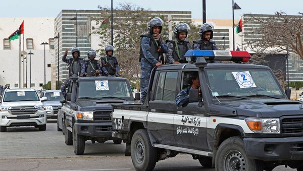 Libyan security forces keep watch outside Ouagadougou Conference Centre in the north-central city of Sirte on March 10, 2021 during a parliament session. - Sputnik International
