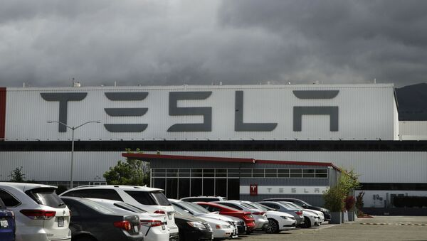 This 12 May 2020 file photo photo shows the Tesla plant in Fremont, California. Tesla is looking to raise up to $5 billion in capital through a stock offering as the electrical vehicle and solar panel-maker seeks to take advantage of strong demand for its products.  - Sputnik International