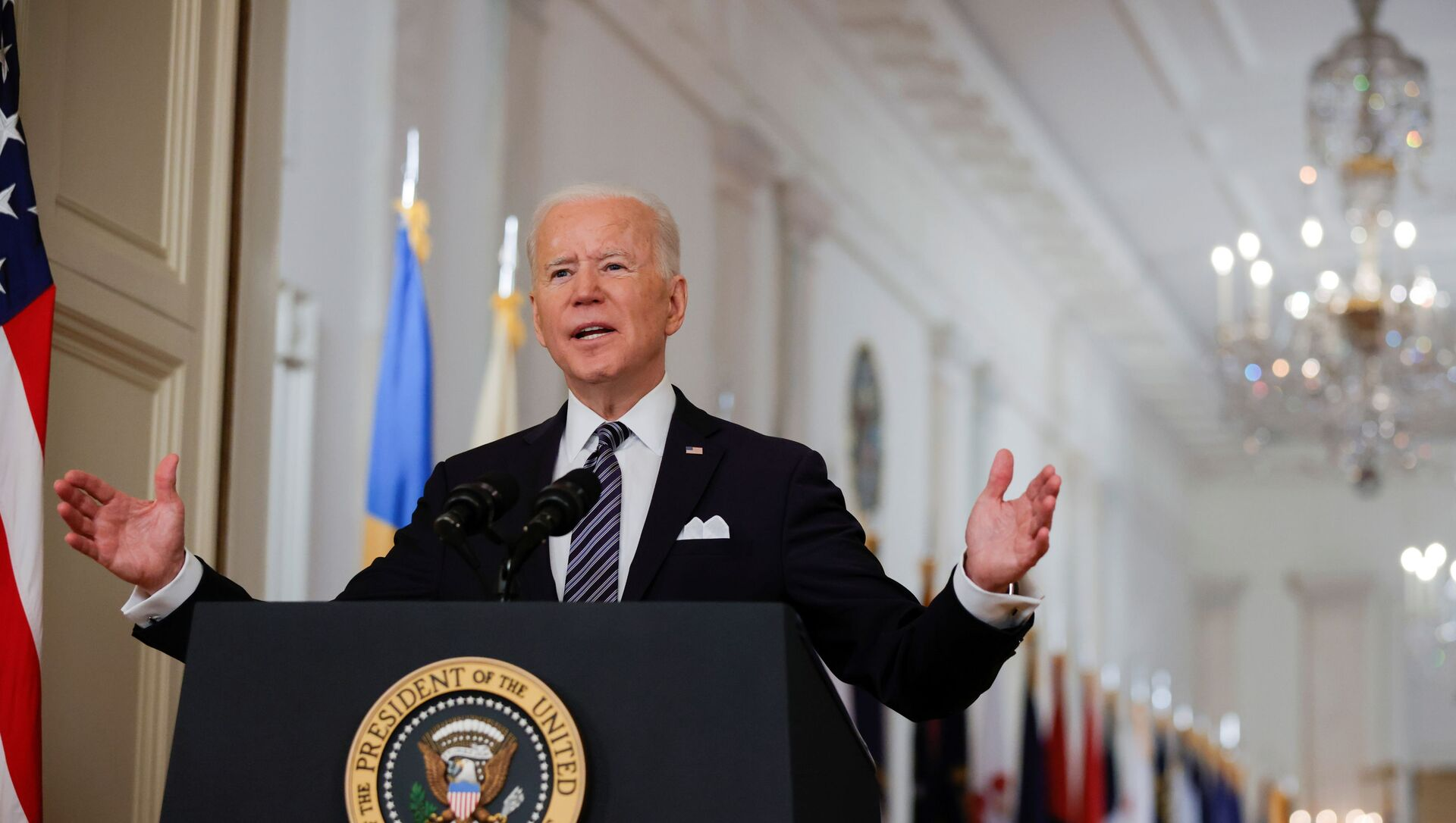 U.S. President Joe Biden delivers his first prime time address as president, marking the one-year anniversary of widespread shutdowns to combat the coronavirus disease (COVID-19) pandemic, and speak about the impact of the pandemic during an address from the East Room of the White House in Washington, U.S., March 11, 2021 - Sputnik International, 1920, 15.03.2021
