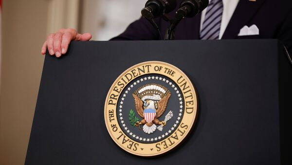 U.S. President Joe Biden rests his hand on the podium as he delivers his first prime time address as president, marking the one-year anniversary of widespread shutdowns to combat the coronavirus disease (COVID-19) pandemic and speaking about the impact of the pandemic during an address from the East Room of the White House in Washington, U.S., March 11, 2021. - Sputnik International