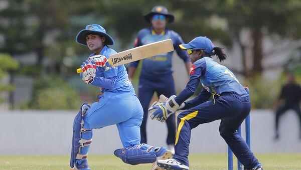 India's Mithali Raj plays a shot during the first Twenty20 women's cricket match against Sri Lanka in Katunayake, Sri Lanka, Wednesday, Sept. 19, 2018 - Sputnik International