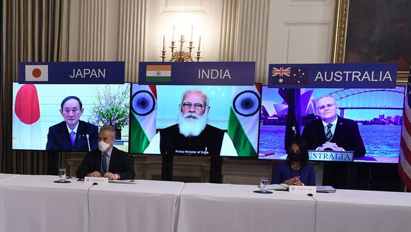 (On screens, L-R) Japanese Prime Minister Yoshihide Suga, Indian Prime Minister Narendra Modi and Australian Prime Minister Scott Morrison listen during a virtual meeting of the Quad alliance members: Australia, India, Japan and the US, in the State Dining Room of the White House in Washington, DC, on March 12, 2021. - Sputnik International