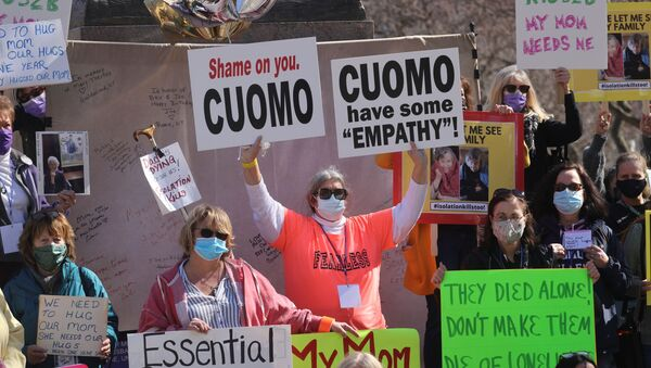 Protestors gather outside the New York State Capitol, following allegations that New York Governor Andrew Cuomo had sexually harassed young women, in Albany, New York, U.S., March 12, 2021 - Sputnik International
