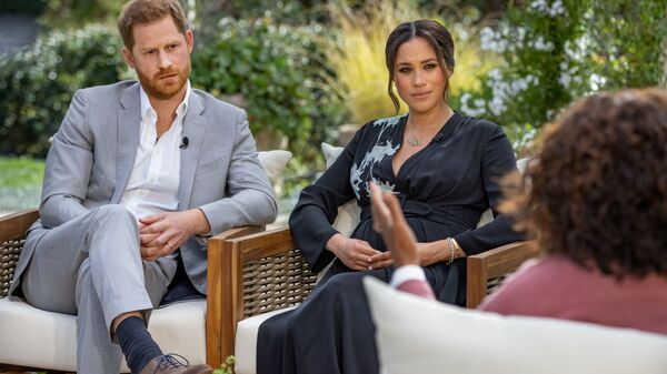 Britain's Prince Harry and Meghan, Duchess of Sussex, are interviewed by Oprah Winfrey in this undated handout photo - Sputnik International