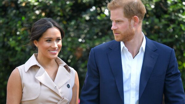 In this 2 October 2019 file photo, Britain's Prince Harry and Meghan, Duchess of Sussex, arrive at the Creative Industries and Business Reception at the British High Commissioner's residence in Johannesburg, where they met representatives of the British and South African business communities, including local youth entrepreneurs. - Sputnik International