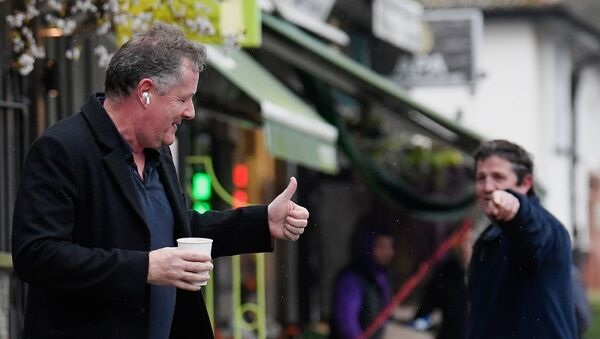 Journalist and television presenter Piers Morgan gestures back to a passerby as he walks near his house, after he left his high-profile breakfast slot with the broadcaster ITV, following his long-running criticism of Prince Harry's wife Meghan, in London, Britain, March 10, 2021 - Sputnik International