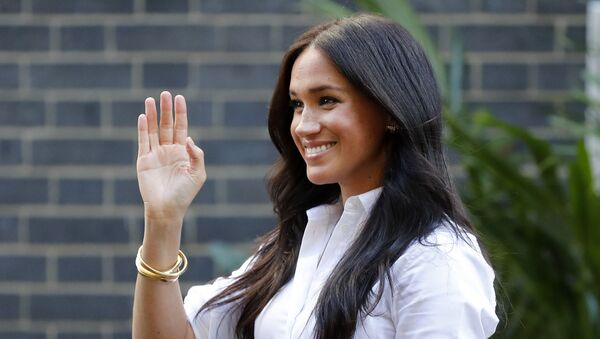 Meghan, the Duchess of Sussex, waves as she leaves a department store after launching the Smart Works capsule collection in London, Thursday, Sept. 12, 2019 - Sputnik International