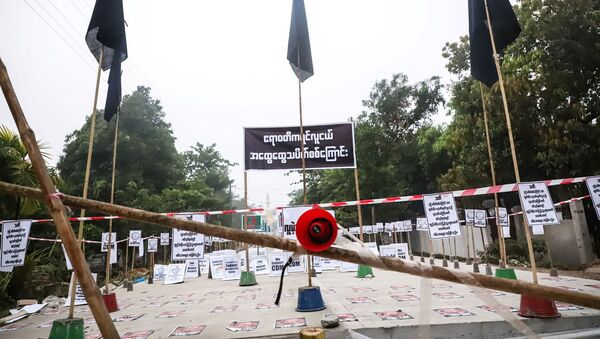 View of a loudspeaker and signs during a protest without demonstrators present in Nyaungdon, Ayeyarwady, Myanmar - Sputnik International