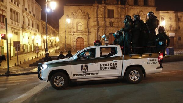 Police patrol in La Paz, Bolivia, Monday, Nov. 11, 2019. Former Bolivian President Evo Morales said Monday he was headed for Mexico after being granted asylum there, as his supporters and foes clashed on the streets of the capital following his resignation.  - Sputnik International
