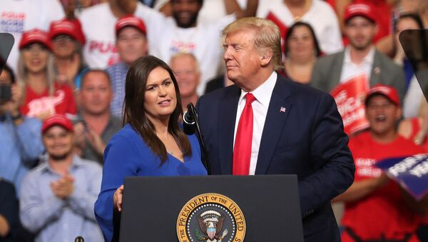 JUNE 18: U.S. President Donald Trump stands with Sarah Huckabee Sanders, who announced that she is stepping down as the White House press secretary, during his rally where he announced his candidacy for a second presidential term at the Amway Center on June 18, 2019 in Orlando, Florida - Sputnik International