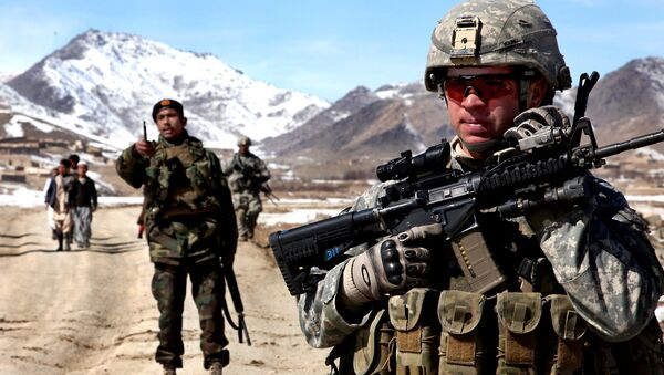 A U.S. Army Soldier patrols with Afghan soldiers to check on conditions in the village of Yawez in Wardak province, Afghanistan, Feb. 17, 2010 - Sputnik International