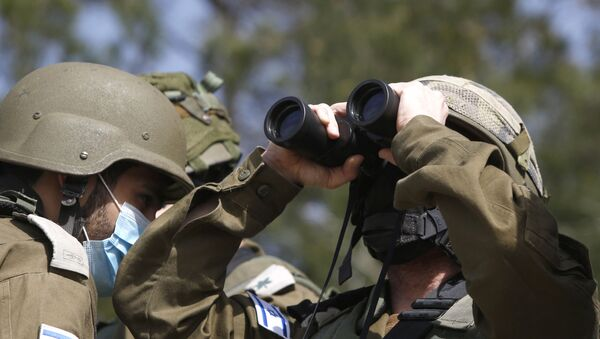 This picture taken on 9 March 2021, near the northern Israeli kibbutz of Misgav Am, shows Israeli forces watching the blue line, a demarcation line drawn by the United Nations to mark Israel's withdrawal from southern Lebanon in 2000.  - Sputnik International