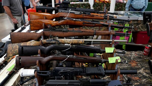 Rifles are displayed for sale at the Guntoberfest gun show in Oaks, Pennsylvania, U.S., October 6, 2017.  - Sputnik International