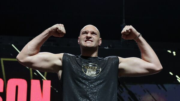 In this Feb. 21, 2020, file photo, Tyson Fury, of England, stands on the scale during a weigh-in for his WBC heavyweight championship boxing match against Deontay Wilder, in Las Vegas. - Sputnik International