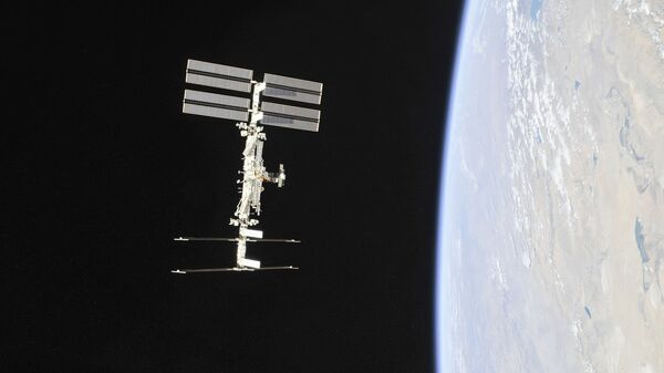 This file NASA handout photo obtained November 4, 2018 shows the International Space Station photographed by Expedition 56 crew members from a Soyuz spacecraft after undocking.  - Sputnik International