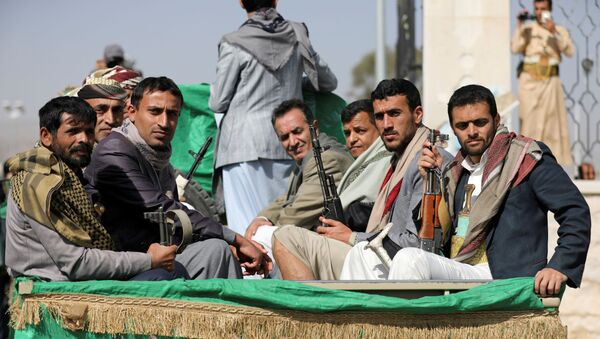 Armed Houthi followers ride on the back of a truck after participating in a funeral of Houthi fighters killed in recent fighting against government forces in Yemen's oil-rich province of Marib, in Sanaa, Yemen February 20, 2021.  - Sputnik International