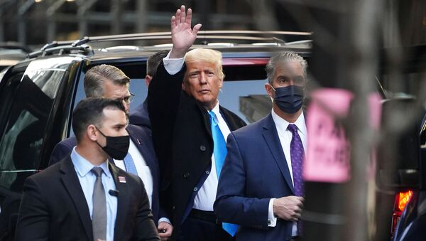 Former U.S. President Donald Trump acknowledges people as he gets in his SUV outside Trump Tower in the Manhattan borough of New York City, New York, U.S., March 9, 2021 - Sputnik International