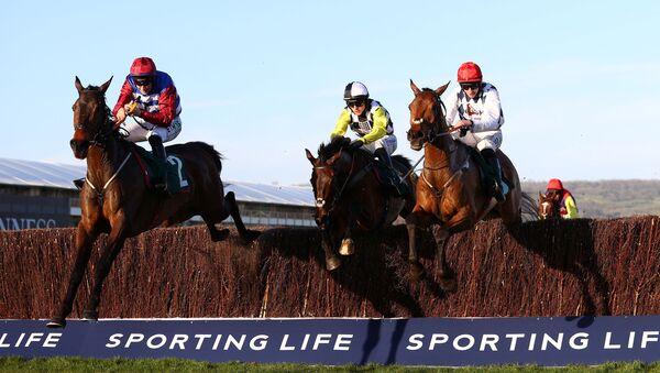 Horse Racing - Cheltenham Festival - Cheltenham Racecourse, Cheltenham, Britain - March 16, 2021  Jack Kennedy riding Galvin (R) wins the 4.50 Sam Vestey National Hunt Challenge Cup Novices' Chase    - Sputnik International
