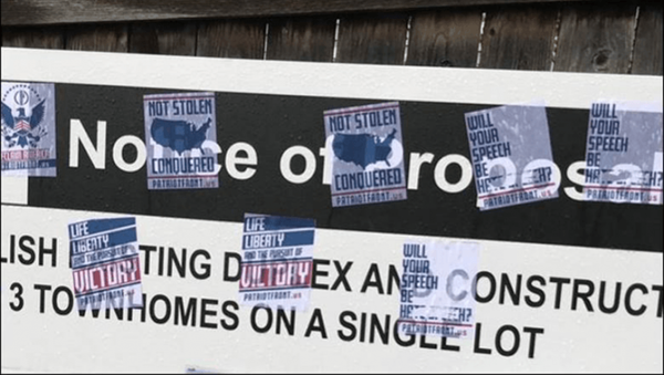 A photo of propaganda posters by the white supremacist group Patriot Front documented by the Anti-Defamation League - Sputnik International