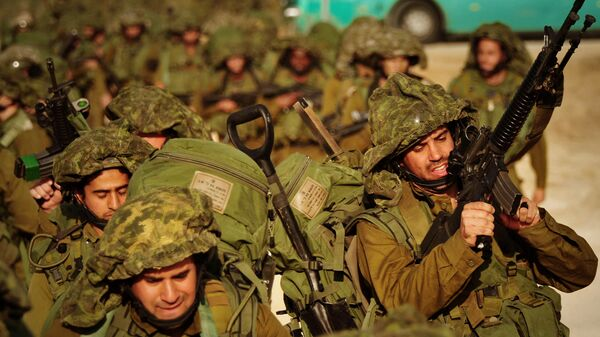 In this photo released by the Israeli army, Israeli soldiers walk towards the northern Gaza Strip as seen from the Israeli border with Gaza, Monday, Jan. 12, 2009. - Sputnik International