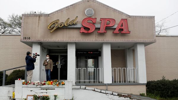 Flowers are laid in front of Gold Spa following the deadly shootings in Atlanta, Georgia, U.S. March 17, 2021 - Sputnik International