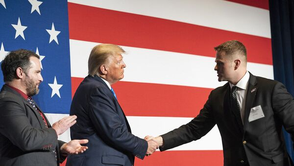 President Donald J. Trump welcomes Army First Lieutenant Clint Lorance and Army Major Mathew Golsteyn to the stage prior to his remarks at the Republican Party of Florida's Statesman Dinner Saturday, Dec. 7, 2019, in Aventura, Fla. Both soldiers were recently granted full pardons by President Trump on November 15th, 2019. (Official White House Photo by Joyce N. Boghosian) - Sputnik International
