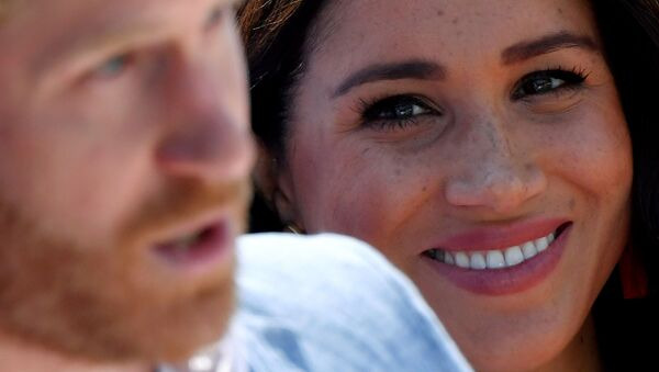 FILE PHOTO: Britain's Meghan, Duchess of Sussex, looks on as Prince Harry, Duke of Sussex, gives a speech, during a visit to the Youth Employment Services (YES) Hub in Tembisa township, near Johannesburg, South Africa, October 2, 2019 - Sputnik International