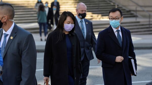 Huawei Technologies Chief Financial Officer Meng Wanzhou leaves court on a lunch break in Vancouver, British Columbia, Canada March 15, 2021. - Sputnik International