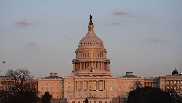 The sun sets on the U.S. Capitol building, Thursday, March 4, 2021, in Washington. - Sputnik International